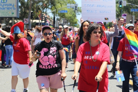 Adrian marching with ACLU SoCal at 2018 Los Angeles Pride